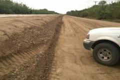 Ejecucion de tareas de extraccion, trasporte de suelo, relleno y compactacion sobre camino de servicio
