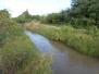 Limpieza de taludes, en ambos márgenes del canal Contrera López